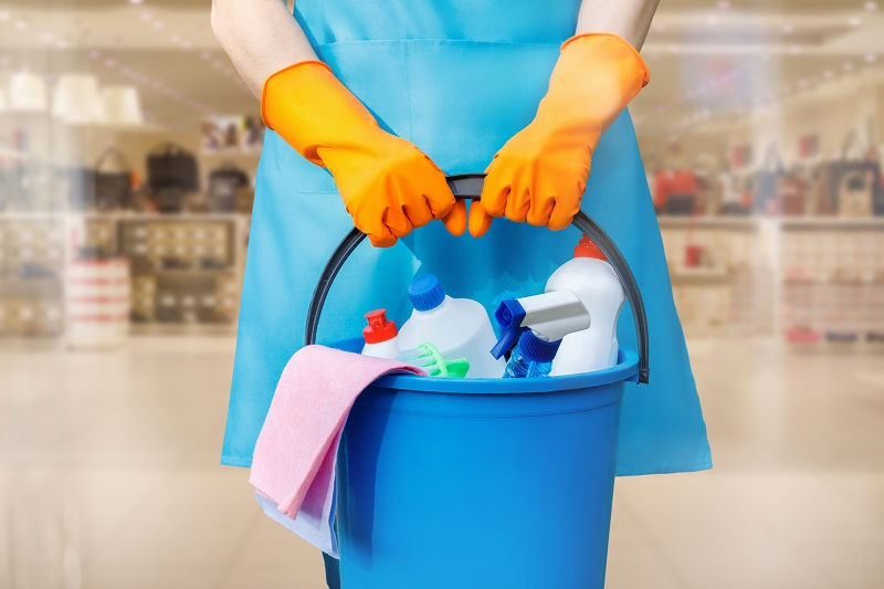 The cleaning lady with a bucket and cleaning products .